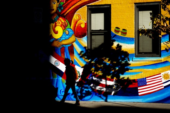 A student walk past the newly painted mural on the Latino Student Cultural Center on Nov. 7, 2016. Photo by Adam Glanzman/...