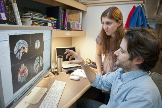 November 29, 2011 - Kevin Bickart and Nicole Betz review brain scans showing the functional connectivity of the amygdala i...
